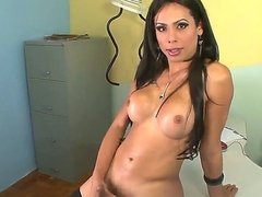 Bruna B is a gorgeous shemale model with long dark-skinned hair, in the matter of tits and hard dick. Mouth-watering transsexual goddess in insidious stockings jerks at the office int his scene.