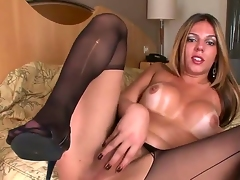Big breasted shemale babe Raissa Nevada wears at great cost black stockings on will not hear of bed as A she grabs will not hear of large meat rod with an increment of strokes it passionately until she reaches an orgasm.